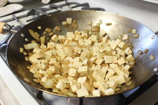 I used a wok because A. it's the largest pan I own, and B. I'm a sloppy cook and it keeps me from flipping the tofu all over the stove top while doin' the choppy choppy on that stuff.